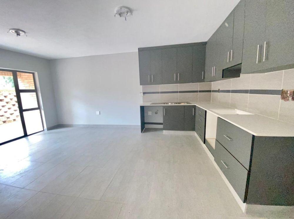 Open plan kitchen ground floor units with dark wood